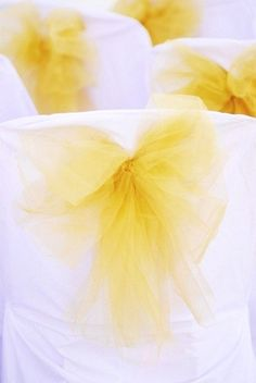 ,chairs decorated with tulle knots for a wedding
