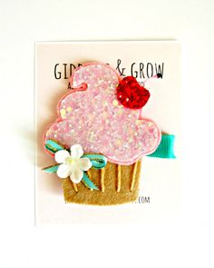 Doesnt even know what a cupcake is- but will know it's delicious. Felt Hair Clips  Glitter Cupcake Hair Clip by giddyupandgrow, $14.00