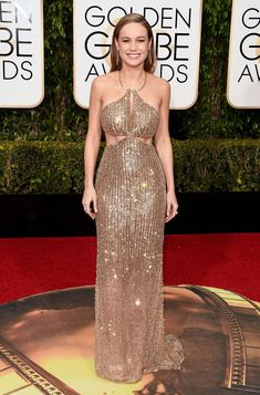 Brie Larson worked her toned physique in an embellished Calvin Klein dress with ab-flaunting cutouts. See more of the Golden Globes' best dressed stars here!