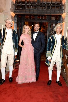 Diane Kruger wearing a Valentino gown from the Spring 2014 collection with Joshua Jackson wearing a Valentino tuxedo from the Fall/Winter 13-14 collection at the Valentino Ball at Palazzo Volpi during the 70th Venice International Film Festival on September 4th 2013 in Venice