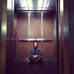 """Victor Webster shot this picture of Richard Harmon in between takes on the set of Continuum Season 2 Episode 11 """"Second Guess."""" Resting in the VPD elevator. (via richardsharmon on Instagram)"""