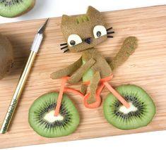 Kiwi kitty on a bike by Cute Fruit, Cute Food, Good Food, Funny Food, Fruit Decorations, Food Decoration, Deco Fruit, Finger Foods For Kids, Fruit Animals