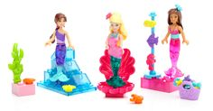 Dive into a brand new ocean of adventure with the Build 'n Play Mermaid Party by Mega Bloks Barbie™! Mermaid Barbie™, Mermaid Nikki™ and Mermaid Teresa™ mini fashion figures can really swim with their colorful, bendable tailfins, splashing and laughing with their included fish and seahorse friends. Create an enchanted undersea scene with sparkling shells and green seaweed blocks. You can even accessorize each mermaid with interchangeable bows! Ideal for kids aged 4 and over. Features: NEW…