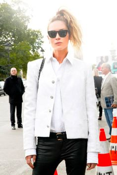 Erin Wasson pairs leather skinnies with a side ponytail #streetstyle