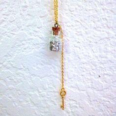"""Cork Vial Necklace by Best Kept Secret Jewelry. 1/2'' Vial w/ Silver Glitter Glass, Gold Best Kept Secret Key Charm, 30"""" Gold Chain"""