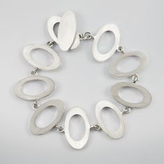 Flat Oval Chunky Silver Bracelet in solid silver by Scarab Jewellery evokes the headiness of London in the sixties - a beautifully modern classic. Chunky Silver Bracelet, Jewelry Photography, Modern Classic, Flats, Jewellery, Personalized Items, Bracelets, Shopping, Loafers & Slip Ons