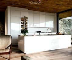 This urbane parallel modular kitchen is super chic and edgy. The mirror-like sheen combined with the wooden floors makes cooking a classy affair. Happiness by Design. #homezop #interiordesign #kitchen #beautifulhomes #renovate #interiors #homedesign #décor #delhi #gurgaon #delhincr #indianhomes #homedecor