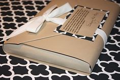 book gift wrap: double craft paper envelope with quotation from the book on the tag: A Gift Wrapped Life