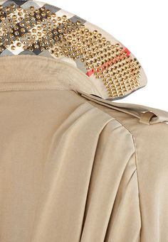 Under collar embellishments. Burberry Trench