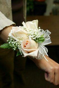 Corsage Featuring: Creamy Blush Rose, Ivory Vendela Roses, White Gypsophila, Greenery/Foliage, White Organza Ribbon..................................