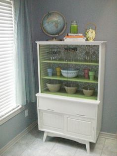 A great after shot of a mid century china cabinet, which is close to the same features of one I have waiting for paint.