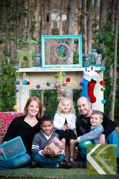 Love this outdoor #holiday photoshoot with an antique wood mantel and ornaments for #christmas cards