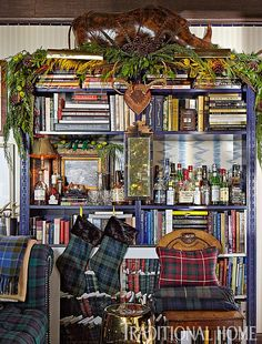 Even a bookcase can get in on the holiday festivities. Drape some garland across the top for added flair. - Photo: John Merkl / Design: Scot Meacham Wood