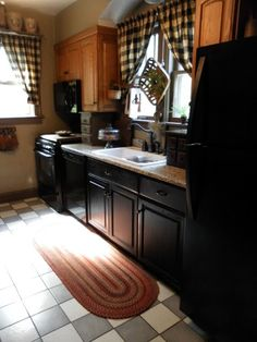 Primitive Country Kitchen with black cabinets | Found on primlish.blogspot.com