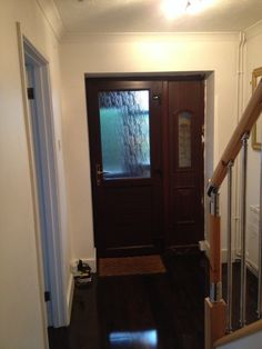 I'd like to get rid of the dark wooden floor and replace it with carpet, something deep and snug to sink into.   There is currently paint all around the doorframe which needs sorting. Ideally I'd like to change the front door but not in the budget just yet! Perfect door would let more light in - maybe wooden with stained glass panels.