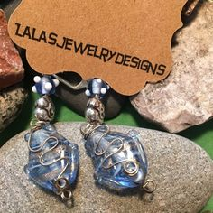 Wrapped Blue Fish Earrings Wrapped in silver wire Blue fish with Sterling silver Flower and a small Lampwork blue and white bead. All on a silver leaver back. Measures 2 1/2 inches.the fish dangles.  LalasjewelryDesigns Jewelry Earrings