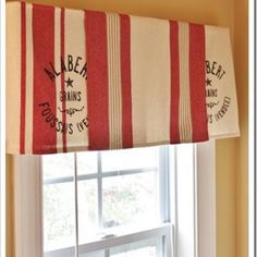 Super easy hand towels turned window treatment!