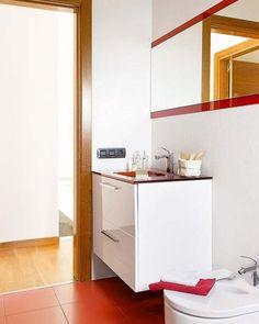 El mueble del lavabo blanco se funde con la pared
