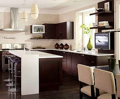 Family-Friendly Design--love the dark cabinets and bright counters.  That contrast fits so well in my dream home!