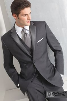 Made from Super 120's Wool, with a tailored fit this 2 Button inset satin notch tuxedo in Charcoal Grey has besom pockets, side vents and nested with a flat front satin striped trouser