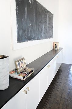 "DIY Furniture: 8 Favorite IKEA ""Fauxdenza"" Tutorials - IKEA cabinets look extra expensive with ebony-stained wood and gorgeous  - bought brass handle - Akurum cabinets 36"" wide x 24"" high with white high gloss Abstrakt doors."