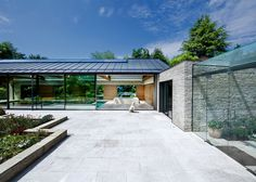 Contemporary pool house by Re-Format combines stone, copper and oak