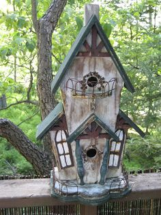 Wonder if there's a 'Romeo' and 'Juliet' bird couple in the trees nearby.       ...  http://dishfunctionaldesigns.blogspot.com/2012/04/for-birds-unique-garden-birdhouses.html