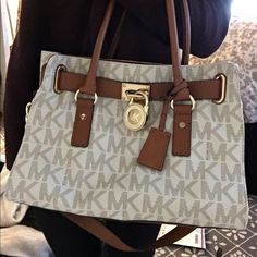 Michael Kors Hamilton Signature Satchel Vanilla It is a slightly used Michael Kors Hamilton Signature bag in the vanilla color. The bag overall is in amazing condition with only minor wear from the few times used. Michael Kors Bags Satchels