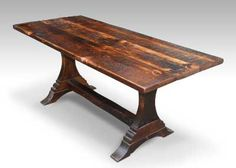 Rustic trestle leg farm table with dark stain