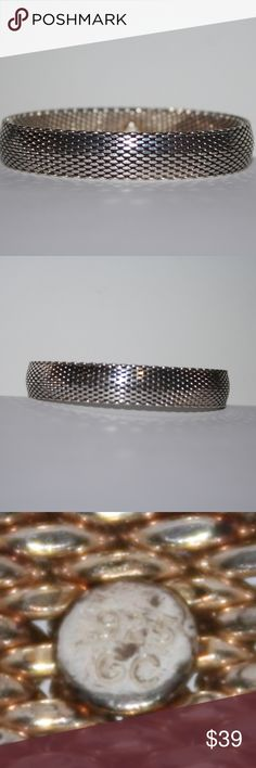 HEAVY .925 Mesh Bangle Bracelet Beautiful bracelet (slightly tarnished... sat in my jewelry box too long) Mesh bangle bracelet. This bracelet is bendy, can change from circle to oval which is amazing for putting on! fits my 7 inch wrist amazing. 2.5 inches across when a complete circle. *i had a hard time listing this one, i hope it goes to a good home*  Buy from me with confidence! I have sold over 500 items with a 5 star rating! If you have any questions, do not hesitate to ask.  Looking…