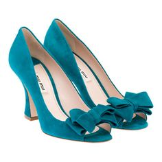 wedding shoes!- since you're possibly renting a dress, why not have some awesome turquise shoes? they can be your something blue!