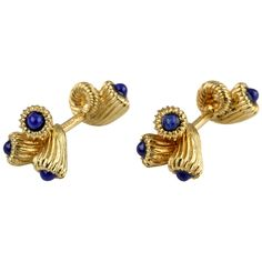 TIFFANY & CO. SCHLUMBERGER Lapis and Gold Cornucopia Cufflinks | From a unique collection of vintage cufflinks at https://www.1stdibs.com/jewelry/cufflinks/cufflinks/