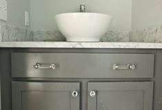 cabinet paint color is Gray Whale by Benjamin Moore.