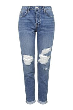 TALL MOTO Rip Hayden Jeans  A medium wash looser fit jean has been in style but what makes these ones special is the distressed look. Women have been doing a small cuff at the base of the jean and pair it with a heel or another interesting shoe.