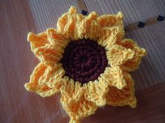 Translator  Powered by Translate  like my blog?  Thursday, June 2, 2011  How to crochet Sunflower  I also make tutorial sunflower.        Row 1:   6x ch  12x HDC    Row 2:   2x sc in each knot. Total: 24sc.   Row 3:   1x ch  2x sc in the next knot  1x sc in the next knot, continue to repeat until the completion of row 3  Row 4:   Hooks 5 chain and sc for each parcel (up). 7 plots all.  Petals, the other threads take, in a box chain and hook 2 dc 1x, 4x triple crochet .. Hooks 3 chain and sc…
