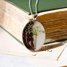 resin jewelry pressed flower necklace. queen annes lace real pressed botanical Pendant. $40.00, via Etsy.