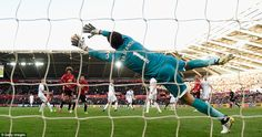 Fabianski dives in vain as Pogba's strike flies past him and into the back of his net with just 15 minutes on the clock