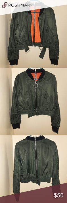 Women's Zara bomber jacket Women's Zara green cropped bomber jacket with orange interior. Zipper in front, black, and sleeves. Front buckle. 2 front pockets. Zara Jackets & Coats