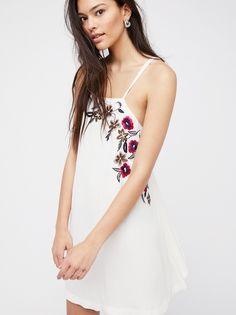 Flower Fields Shift   Simple shift dress featuring beautiful floral embroidery and a strappy back design.    * Hidden side pockets * Ultra lightweight fabrication