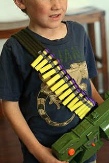 Nerf dart ammo belt made from a cotton belt and stitched-down ribbon
