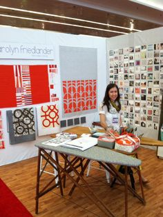 Carolyn Friedlander in her booth featuring Botanics and Architextures; lines she designed for Robert Kaufman Fabrics