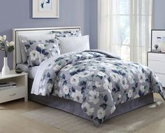 The Blooming Floral Complete Bedding Set by Essential Home is a chic choice for any sleeping space. Featuring a subtle floral pattern of white and blue blossoms on a soft grey background, this bedding set is soothing to the eye, as well as luxuriously comfortable. Sizes available accommodate any bed size and the pieces are machine washable for easy care. Make any bedroom decor spring to life with the addition of this complete bedding set.