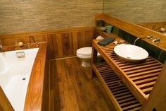 Wood-planked, Japanese style bathroom. Price details for this home remodel project available on www.Porch.com