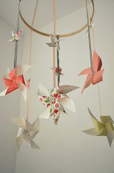 homemade ribbon and paper baby mobile!  Go with some scrap vintage prints to make it match your nursery colours.