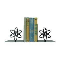 For the chemistry aficionado charged with a messy bookshelf, the Positively Negative Bookends are an ideal solution. Nestle scientific journals, textbooks, or your favorite works of science fiction bet...  Find the Positively Negative Bookends, as seen in the The Classic California Ranch Home Collection at http://dotandbo.com/collections/the-classic-california-ranch-home?utm_source=pinterest&utm_medium=organic&db_sku=106822