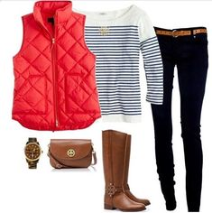 Red vest, striped blue top, brown belt, black jeans & brown boots