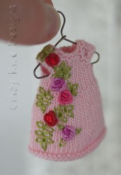 Summer Roses, a hand knit and embroidered dress for Amelia Thimble dolls. cindyricedesigns.com