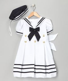 This set captures the timeless style that goes into seafaring fashion. A sailor collar pairs with nautical colors and military buttons on this back-zippered dress, but it's the added surprise of a prim little hat that will have everyone saluting its sweetness.