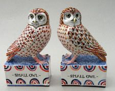 Pair small owls. Modelled red clay, semi porcelain slipped, decorated with colours and oxides, clear glazed and fired. David Cleverly