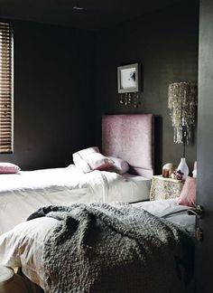 Love this blush headboard and pillows agains the dark gray.